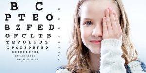 eye chart girl covers eye 1024×512